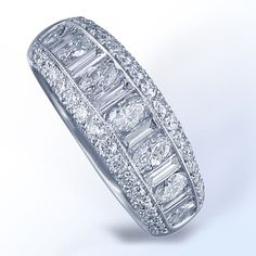 JB Star Platinum Marquise, Baguette, and Round Diamond Wedding Band, available now at King Jewelers