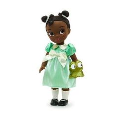 Beautiful Tiana looks cuter than ever as this adorable Animator doll! Featuring realistic hair, an endearing expression and a pretty satin dress, the posable princess is kept company but a cute satin Naveen soft toy. Tiana, Pinocchio, Walt Disney World, Collection Disney, Disney Animators, Mickey Mouse, Disney Store, Keep Company, 8 Year Old Girl