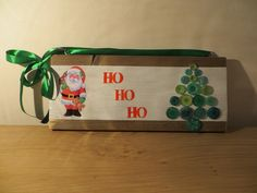 Ho Ho Ho Merry Christmas! Happy Santa on a wooden decoration peace. Button art on the side.