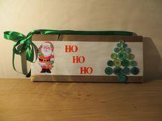 Ho Ho Ho Merry Christmas! Happy Santa on a wooden decoration peace. Button art on the side.