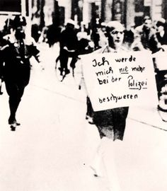 """Dr. Siegel, a Jewish lawyer, being marched in Munich under SA escort; the sign he wears reads: """"I will never again complain to the Police"""". 10/3/33"""
