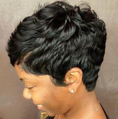 Want to add a lil sumthin sumthin to your boring short pixie cut? Try this super cute style. The part and the feathered sides make it too fly!