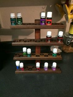 Essential Oils rack version 2.0. Now available to order fro. JK Forever Woodworking. www.facebook.com/jkforeverwoodworking $75 FREE Shipping in the US Essential Oil Rack, Shop Displays, Natural Solutions, Custom Woodworking, Young Living Essential Oils, Display Ideas, Wine Rack, Liquor Cabinet, Woods