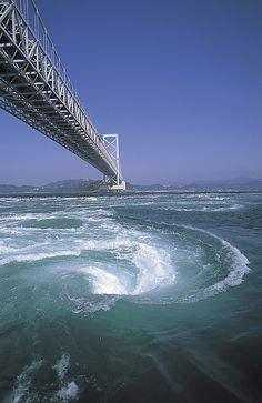 Onaruto Bridge connecting Kobe and Naruto, Tokushima, Japan. The bridge is one of the largest bridges in the world and is also known for the Naruto whirlpools. The Naruto whirlpools are caused by tidal currents between the Seto Inland Sea and the Pacific Ocean. (Wikipedia)