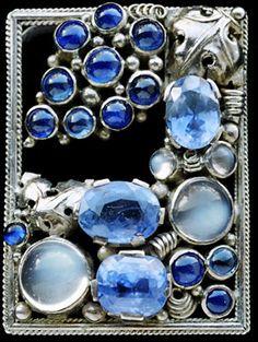 DORRIE NOSSITER 1893-1977  Arts & Crafts Clip   Silver, sapphire & moonstone  Length: 4cm Width: 2.8cm  English. Circa 1930