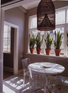 plants in window. Lucite , round table for small space