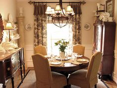 This is a wider view of the dining room with the white plate collection that I love. This room is great - very cozy and warm.