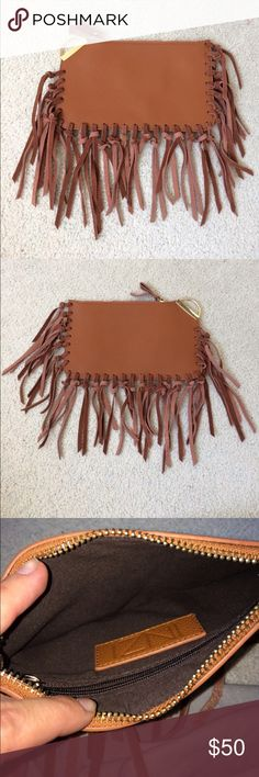 """INZI Cognac Vegan Leather Fringe Clutch NWOT Never worn beautiful faux leather cognac fringe clutch with gold hardware. Has a couple tiny scratches on the gold part from storage but barely noticeable! Has inside zipper pocket as well as top zipper closure. 9""""x5.5"""" INZI Bags Clutches & Wristlets"""