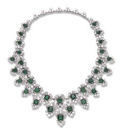 A MAGNIFICENT EMERALD AND DIAMOND NECKLACE, BY BULGARI   Composed of a graduated series of square-cut emeralds, each within a circular and baguette-cut diamond surround, spaced by twin circular-cut diamonds, the front suspending a similarly-set diamond and emerald fringe, to the baguette-cut diamond line backchain, enhanced by circular-cut diamond three-stone clusters, mounted in platinum, 15¾ ins., in a Bulgari green leather fitted case