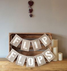 A personal favourite from my Etsy shop https://www.etsy.com/uk/listing/516772491/flip-flops-hessian-bunting-banner