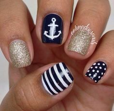 Gold glitter and navy blue and white striped polka dot nails art