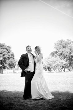 An amazing Wish Upon a Wedding at the Thomas Welsh Activity Center in the Lake St. Clair Metro Park featuring teal, orange and white accents. Love this black and white photo of the bride and groom!