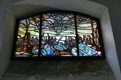 There is also a beautiful series of 13 small stained-glass windows, made by the sadly defunct concern Mauméjean, depicting some of the greatest battles of the war, and featuring images of biplanes, barbed wire, howitzers, early tanks and burning cathedrals. It's a reminder of why these sarcophagi are here, in this park outside Paris. So is the epigraph you pass on your way back up the stairs into daylight and life:  And in their death they were not divided