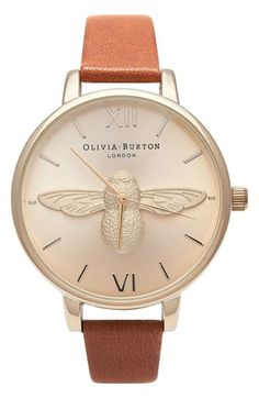Free shipping and returns on Olivia Burton 'Molded Bee' Leather Strap Watch, 38mm at Nordstrom.com. An intricately molded bee centered on a glowing sunray dial exudes this round watch with Olivia Burton's signature nature-inspired whimsy. A highly polished case and smooth leather strap bring feminine glamour to the fanciful design.