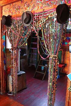 COOL. Back in the day you would have to be Janis Joplin or Grace Slick to own such a beautiful beaded curtain. I see this modern version is covered in little price tags. Must be sold by the strand!