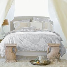 Tess Duvet  Gorgeously understated, Tess features a grand damask floral in the subtlest color combination. Dove damask with flax linen piping and button closures. Pair with flax linen bed skirt and Color Frame shams for an effect that is naturally grounding.