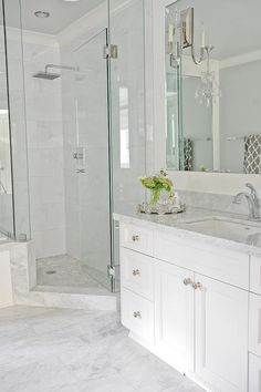 Going for this look. Light grey floor tiles, white vanity, quartz countertop, white stacked wall tiles with accent tiles, and niche.  Cabinet - Strasser..Finial Kohler Faucet and showerhead. Oval undermount sink, American STandard Optum VorMax toilet, solid surface shower pan.