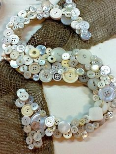 DIY Button Craft: DIY Button. It would make a very unique bedroom or apartment door decoration.