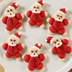 Using your favorite sugar cookie dough and a few food colors, you can create these truly adorable Christmas cookies. We shaped them like snowmen, Santa, trees, and stars for a festive holiday dessert./