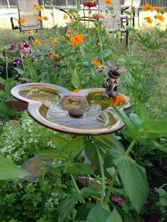 Mickey Mouse birdbath in garden.  I want this in my flower garden; just 2 cute!! ❤