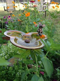 Mickey Mouse birdbath in garden. I want this in my flower garden; just 2 cute!! ❤