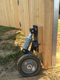 Fence gate wheel w shock Backyard Projects, Outdoor Projects, Home Projects, Backyard Ideas, Garden Ideas, Shed Plans, Garden Gates, Home Repair, Outdoor Living