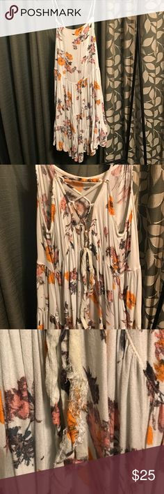 Intimately Free People Circle of Flowers Slip Pretty floral slip with deep-v in back with string to tie. The third image shows how part of the string had come unraveled, but the actual slip is in good condition. Free People Intimates & Sleepwear Chemises & Slips