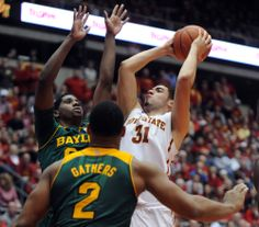 Iowa State's Georges Niang takes a shot between Baylor's Royce O'Neale and Rico Gathers (2) during second half at Hilton Coliseum on Tuesday, Jan. 7. Photo by Nirmalendu Majumdar/Ames Tribune