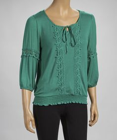 Crocheted accents combines with a soft and lightweight feel, while a shirred hem creates a blouson silhouette.Measurements (size S): 24'' long from high point of shoulder to hem95% rayon / 5% spandexHand wash; hang dryImported
