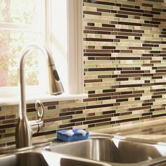 Mosaic glass tiles with a unique design are perfect for a kitchen backsplash.