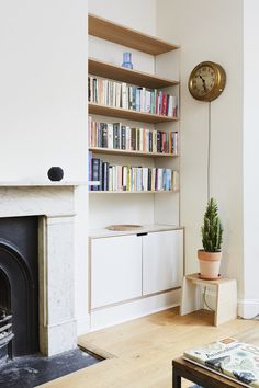 Built in alcove storage, laminated and exposed plywood mix with cabitnets below and shelving above Alcove Bookshelves, Alcove Shelving, Fireplace Bookshelves, Bookcase, Alcove Storage Living Room, Living Room Shelves, Home Living Room, Alcove Cupboards, Built In Cupboards