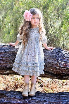 soft wildflower printed dress boasts three rows of ruffles along the bottom as well as ruffles at the collar and sleeves.  Light pleats at the bodice gives it a hint of structure amidst its flowy sillouhette,