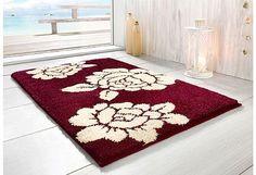 badmatten: Donkerpaars met witte bloem