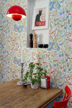 Josef Frank wallpaper and Verner Panton lamp