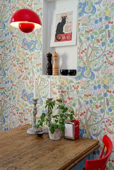 Josef Frank wallpaper and Verner Panton lamp