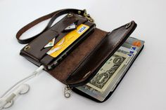 Dark chocolate  bifold leather iPhone wallet  wristlet  with large zipper. $37.50, via Etsy.