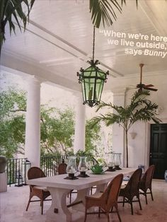 On the dining loggia, an antique wrought-iron lantern illuminates a french limestone table surrounded by wicker chairs. Escape to Bunny Williams and John Rosselli's Majestic Seaside Home Photos British Colonial Decor, French Colonial, Outdoor Rooms, Outdoor Living, Outdoor Patios, Outdoor Kitchens, Indoor Outdoor, West Indies Style, West Indies Decor