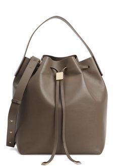 Handmade  Gvyn taupe leather bucket bag  Top handle, detachable adjustable shoulder strap, designer stamp, gold hardware, internal zipped pocket, detachable pouch, fully lined  Drawstring top  Comes with a dust bag
