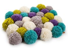 Fluff up your floor with a cozy Pom Mat! With the help of a Pom Maker, you could have the cutest mat to match any space in your home! These are even a perfect addition to a dorm room!