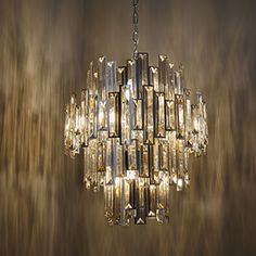 This impressive 15 light pendant is a modern take on the chandelier. Champagne crystal drops and a chrome effect trim create a dazzling effect. Compatible with LED lamps and dimmable. Available in 2 sizes. |Compatible with LED lamps|Dimmable|Complete with fixing accessories|Chrome plate & champagne crystal glass|Constructed from steel & crystal glass