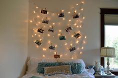 Love the way the photos have been hung on the fairy lights in this room