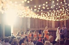 White lights add a touch of elegance to this barn wedding