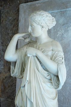 """""""Diane de Gabies"""" by the Greek sculptor Praxiteles, son of Cephisodotus the Elder, 4th century BC. Here, Artemis is wearing a chiton (long tunic) for hunting, and putting on a mantle. Its name comes from its discovery in the Roman city of Gabies."""