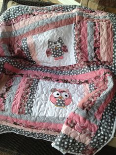 Grey, pink, and mauve baby girl owl quilt. $135.00, via Etsy.