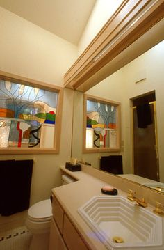 Bathroom with indirect lighting and stained glass window