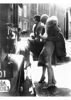 1920's glamour - looks like the twenties were a little chilly, good thing they could all wear those fabulous furs