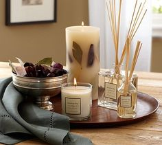 "Homescent Collection - Mission Fig  Featuring the distinctive fragrance of ripe fig, with notes of jasmine, geranium and pine, mingled with Baltic amber and sandalwood, our Homescent Collection comes specially packaged to create a welcome holiday gift.  Botanical Pillar: 4"" diameter x 8"" high.  Candle Pot: 3"" diameter, 3.5"" high."