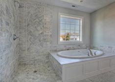 3x6 marble tile shower with 4x4 tile design inset with pencil tile.  East Coast Tile Inspiration