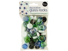 Decorative Glass Rocks, 48 - Perfect for holding flowers in bowls or vases, these Decorative Glass Rocks feature shiny rounded rocks in opaque white, opaque black, transparent blue and transparent green. Comes with 9 ounces of rocks. Comes packaged in a poly bag with a header card.-Colors: black,white,green,blue. Material: glass. Weight: 0.5552/unit