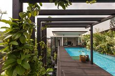 Hidden amongst the dwellings of modern tropical hideaways in a sublime suburb of Singapore is Aamer Architects' recently completed Adrian's Garden Villa.